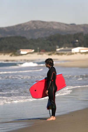 bodyboarder at the coastline photo