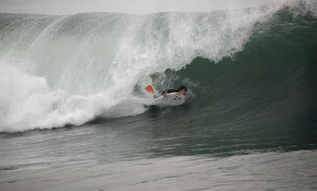 plucky: photo of a bodyboarder in the tunnel Stock Photo