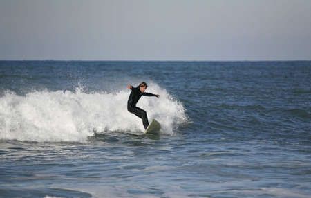 plucky: surfer with a black suit