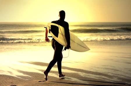 recreate: sunset surfer running in the beach