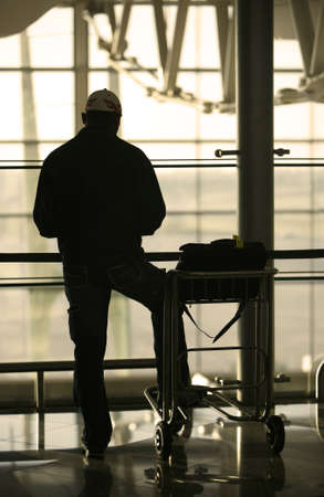 airport check in counter: man and trolley at the airport