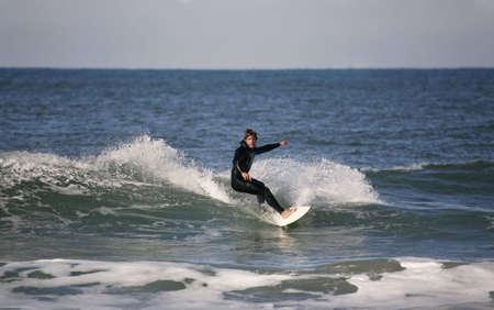 cutback: surfer making a forehand cutback