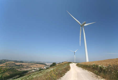 conservational: photo of a road with wind turbines