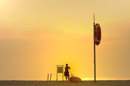 diving save: photo of a lifesaver at sunset
