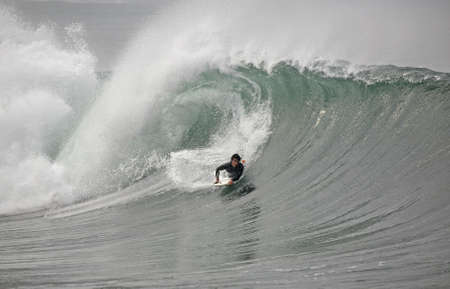 plucky: bodyboarder in the wave
