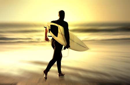 sunset surfer running in the beach warp version photo