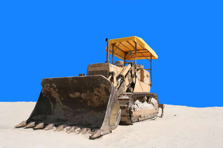 bulldozer in the sand with blue background Stock Photo - 920332