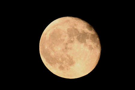 insanity: luna en un fondo negro  Foto de archivo