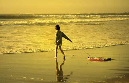 enters: little bodyboarder enters the sea