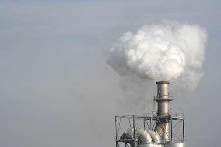 factory chimney producing a smoke Stock Photo - 1005240