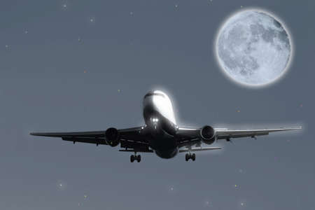 blustery: Airliner flying with moon in background Stock Photo