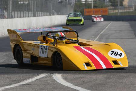 yellow race car in the corner Stock Photo