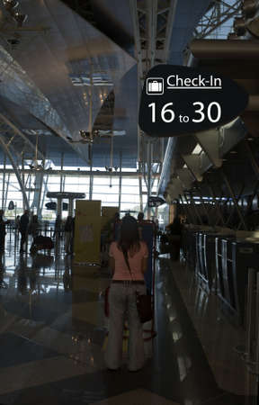 people waiting for check-in in the airport Stock Photo - 1327642