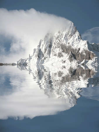 mirrored top of mountain with snow in picos da europa Stock Photo - 1746183