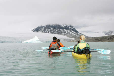 jostedal: two couples kayaking in norway