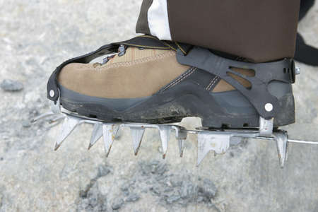 crampons: Boot with crampons in ice Stock Photo