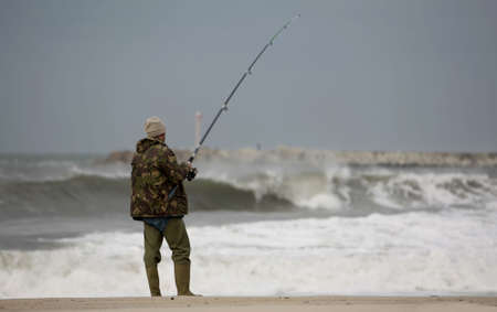 fisherman with waves Stock Photo - 2038683