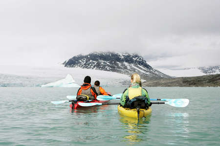 two couples: two couples kayaking in norway