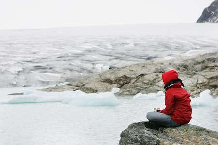 girl in meditation at Jostedalsbreen glacier photo