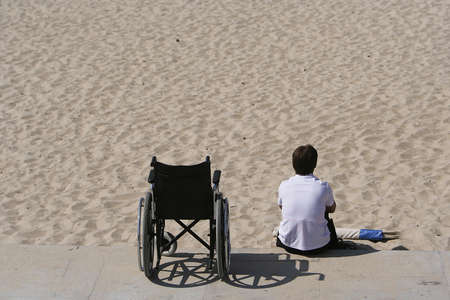 medicine wheel: woman and wheel chair in the beach
