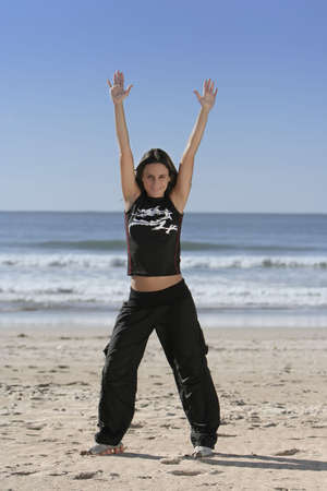 woman stretching at the beach Stock Photo - 2504399