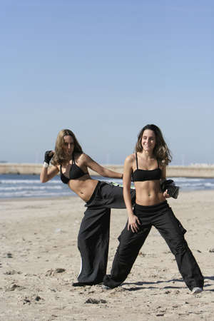 twins training in the beach Stock Photo - 2504407
