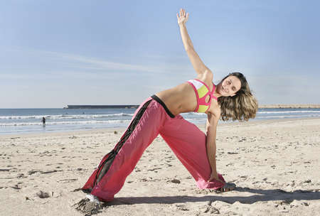 woman stretching at the beach Stock Photo - 2521422