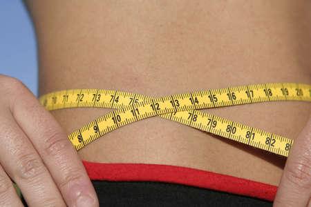 measure tape around girl waist Stock Photo - 2564251