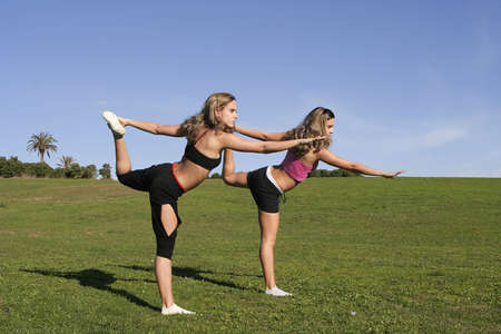 twins stretching in the park Stock Photo - 2583547