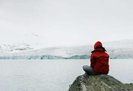 alaska scenic: girl in meditation at Jostedalsbreen glacier