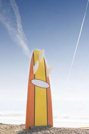 recreate: surf board in a blue sky