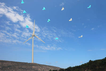 conservational: wind turbines with kites in the sky