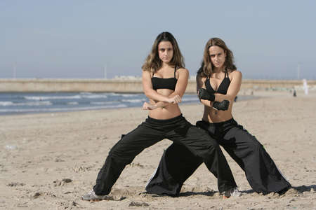 twins training in the beach Stock Photo - 3070001