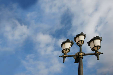 crusted: old lamp against blue sky