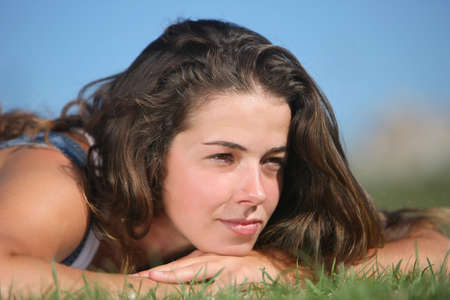 sweet woman rest on the grass Stock Photo - 4208176