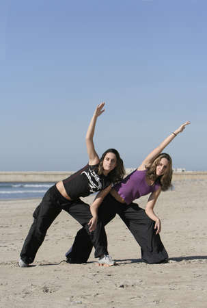 twins working out in the beach Stock Photo - 4289656