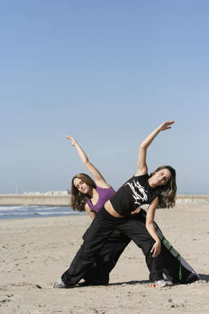 twins working out in the beach photo