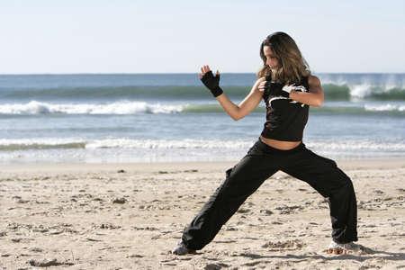 girl fighting in the beach Stock Photo