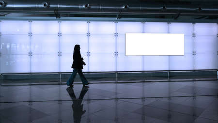 woman walking in the airport photo