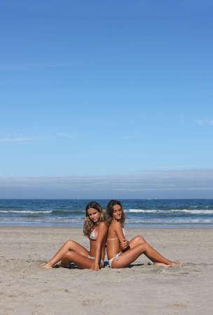 twins having fun in the beach photo