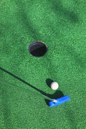 Mini Golf bal on a green background