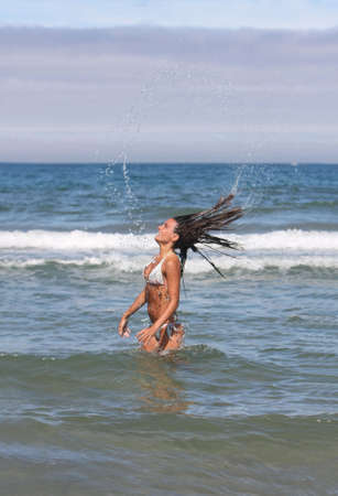 girl with long hair in the sea photo
