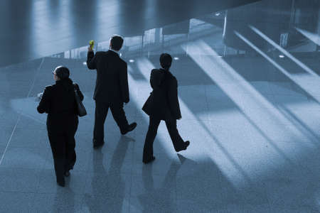 business people walking in the airport photo
