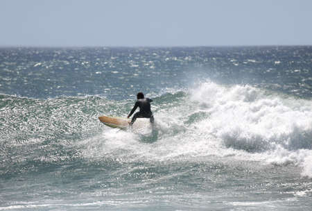 plucky: surfer in the wave Stock Photo