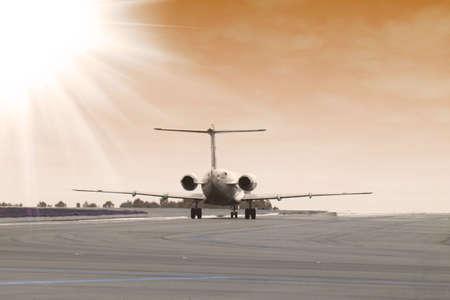 airplane landing at sunset photo