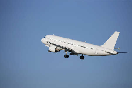 blustery: airliner taking off in a blue sky Stock Photo