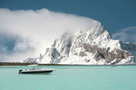 luxury boat on the sea with a mountain with snow in the background
