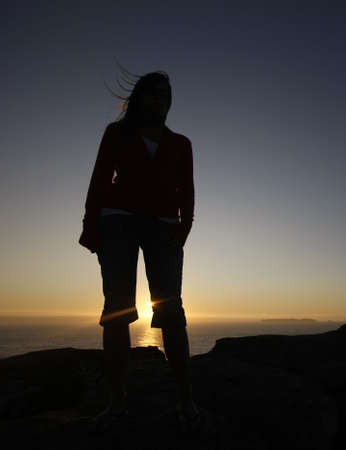 woman silhouette in th mountain at sunset Stock Photo - 7052791