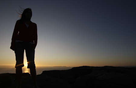 woman silhouette in th mountain at sunset Stock Photo - 7052795