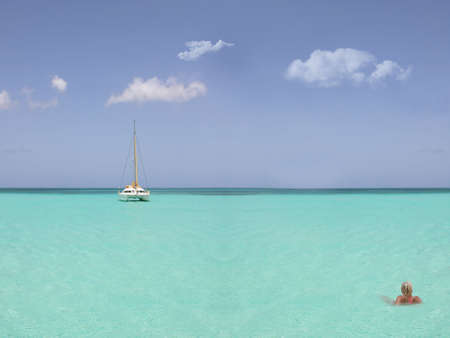 catamaran: blond woman in the sea with a catamaran